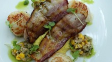 Go-to dish: Seared scallops, Skara bacon, corn puree, farro and basil salsa at Cafe Sydney.