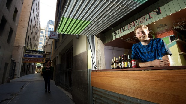 Bar with a conscience: Simon Griffiths' non-profit Shebeen livens up Manchester Lane.