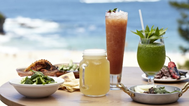 Feast on grilled seafood and sip cocktails while soaking up the beach views on the Coogee Pavilion rooftop.