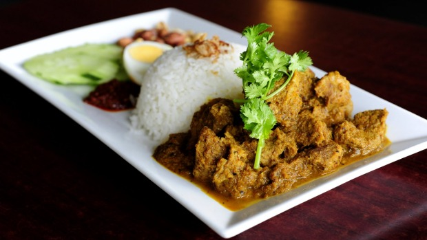 Nasi Lemark with beef Rendang.