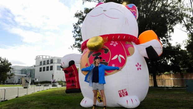Event manager of operations Alexandra Burgess  with Lucky Cat, who will welcome Canberrans to the Night Noodle Markets ...