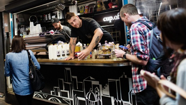 Baristas John 'The Textbook' Freeman (L) and Courtney 'The Architect' Patterson serve early morning coffee at Cup Of Truth coffee shop in Degrees Street Subway below Flinders Street in Melbourne.