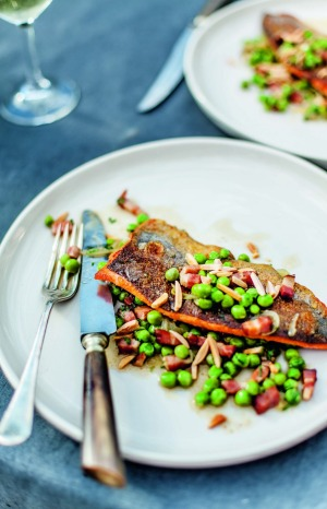 Pan-fried trout with braised peas from the <i>River Cottage Australia Cookbook</i>.