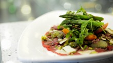 Carpaccio di manzo: Balsamic glazed beef carpaccio, drizzled with olive oil and lemon juice, with rocket and parmesan.