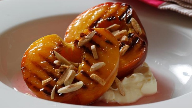 Warm peaches with creamy ricotta and rosewater syrup.