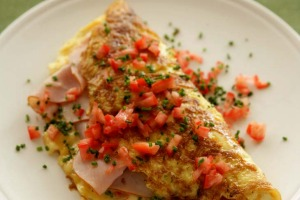 Ham, cheese and tomato omelette.