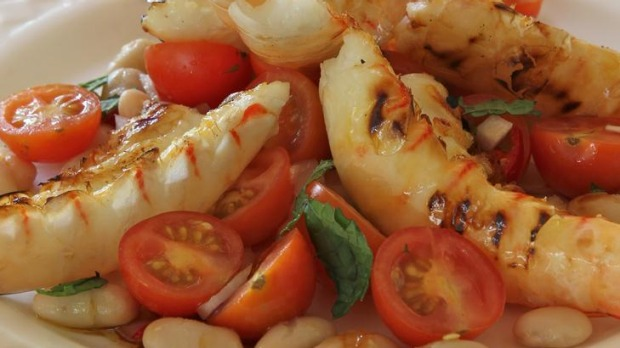 Cherry tomatoes with barbecued prawns.