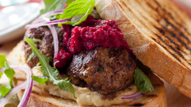 Meatball sandwich with hummus and beetroot.