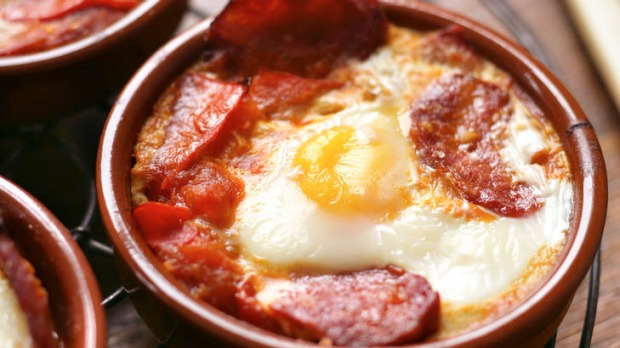 Baked Eggs with tomato, parsley & chorizo.