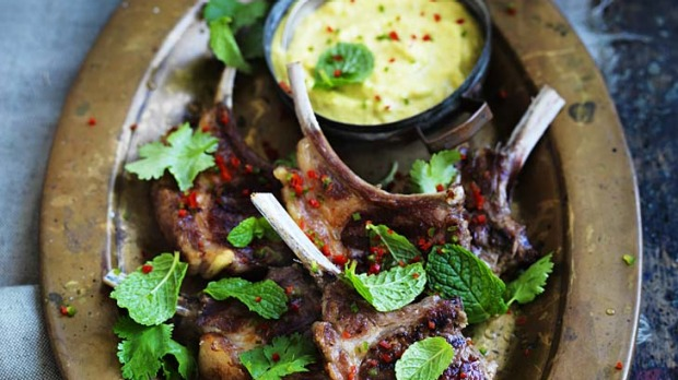 Barbecued lamb cutlets with spicy yoghurt sauce.
