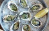 Oysters baked in their shells. <a ...