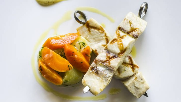 Pretty and subtle: Kingfish skewered, served on braised leeks and carrots.
