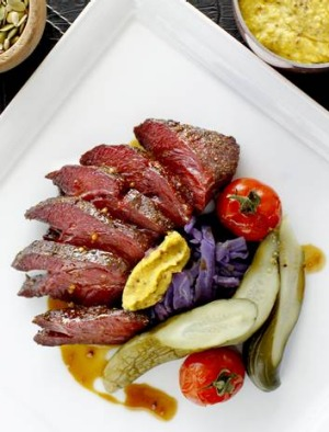 Soft and lightly smoky ... hot-spiced pastrami with smoked tomatoes, pickles and mustard.