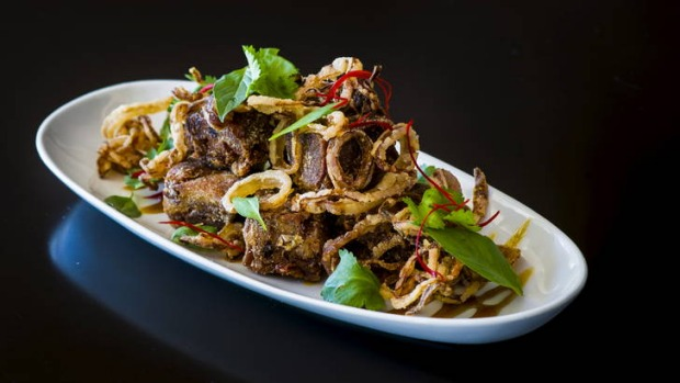 Crispy pork hock with palm sugar caramel and crispy fried onion.