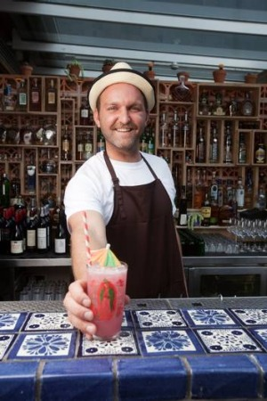 Mix and match … El Topo's Luke Redington with the club's namesake mescal-based cocktail the ''El Topo'' made with ...