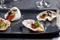 Crisp and decadent ... Prawn crackers with salmon roe, nashi and roasted chilli.