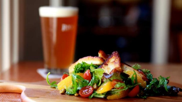 Heady stuff … haloumi and a beer at Harts Pub.