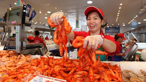 Bucketloads of prawns ... Tran Nguyen of Claudio's shows off large cooked tiger prawns from the Clarence River.