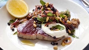 Unilateral seared tuna steak with pinenuts, currants and mint. Karen Martini FISH recipes for Epicure and Good Food. ...
