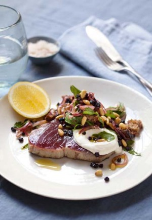 Seared tuna steak with pine nuts, currants, sorrel and mint.