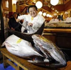 Kiyomura Co's President Kiyoshi Kimura, who runs a chain of sushi restaurants, poses with a bluefin tuna in front of his ...
