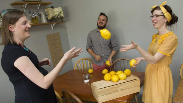 Lady Bower cafe owners Jason Chan and Vanessa Nitsos receive lemons from the garden of regular customer Kate van der Drift.