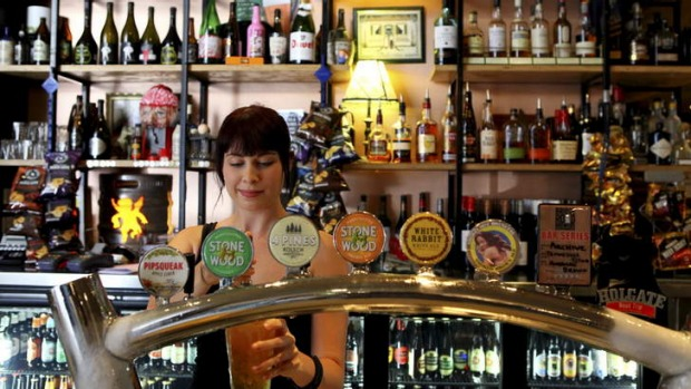 Top taps ... Freya Simmons works the bar at Archive Beer Boutique in West End.