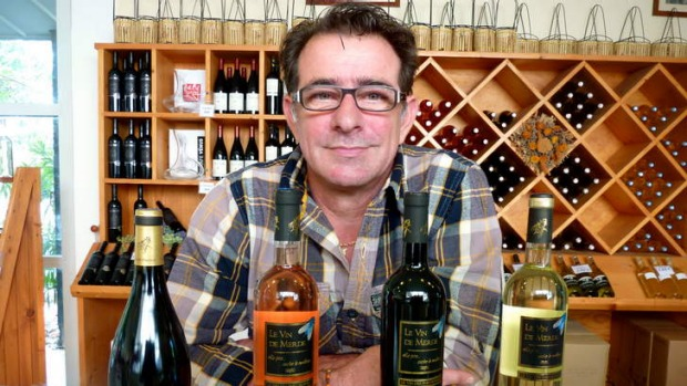 Last laugh ... Vin de Merde founder Jean-Marc Speziale with the bottles, four years on and still going strong.