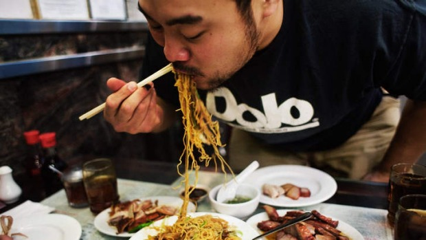 Momofuku's David Chang eating at Great NY Noodletown, New York.
