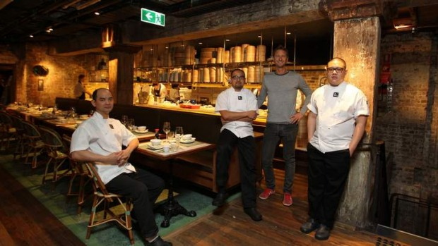 Culinary revolution ... Justin Hemmes (in grey) with Mr Wong chefs, left to right: Eric Koh, Jowett Yu and Dan Hong.