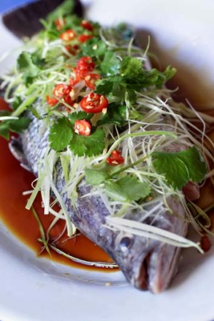 Abundance and unity ... whole steamed fish served with the head and the tail is traditionally the final dish of the New ...