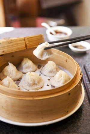 Slurp out the soup first in the xiao long bao at HuTong.