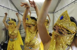 Celebrating the new year ... performers rehearse The Golden Snake Dance backstage.