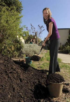 Jennifer McMillin shovels Hot Rot compost at the Canberra Environment Centre, Acton.