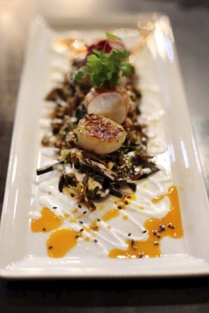 Seared scallops with crispy banana blossoms and chilli jam dressing.