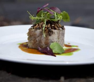 Confit duck terrine with a cointreau and burnt orange dressing, mustard cress and puffed wild rice.
