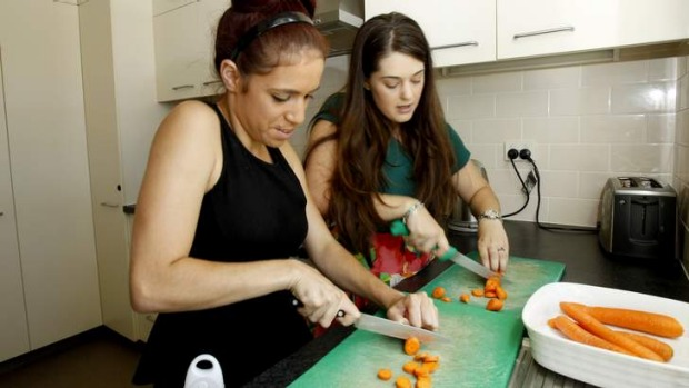 Charity cooking … Bianca gets tips from Angie Sceats.