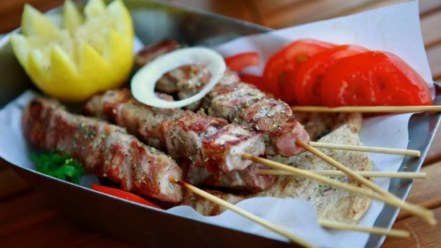 Excellent smoky pork skewers are hot off the grill.