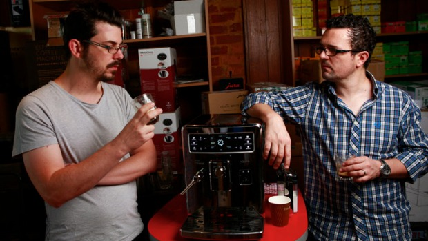 Baristas Craig Simon (left) and Dave Makin sample espresso from the Saeco Xelsis ID.