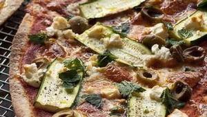 Frank Camorra whips up a couple of pizzas.