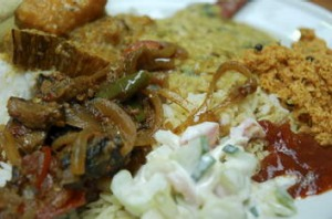 For a vego CBD lunch, $8.50 buys three vegetarian curries with rice and condiments at Jolly J's.
