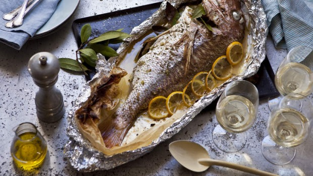 Whole snapper with dried oregano and lemon.