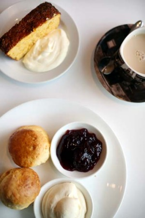 Deliciously affordable: A pair of fresh scones, jam and whipped cream, with a pot of tea for $6.