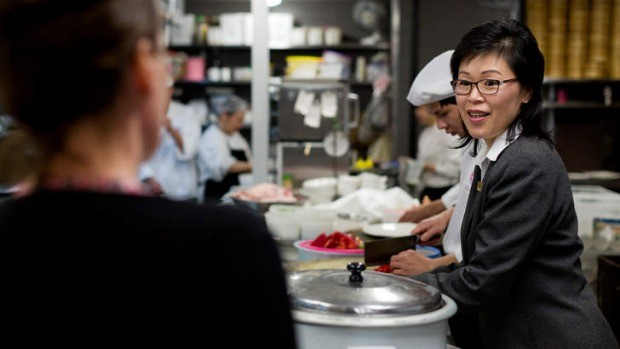 Red Emperor manager Christine Yong and chef Hon Kau Hui brief Justine Costigan on the art of fried rice.