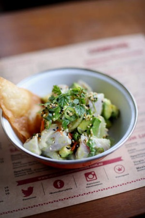 Go-to dish: Ceviche of kingfish with chervil, avocado, grape and lime candied sesame seeds.