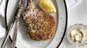 Satisfying crunch: Crumbed veal cutlet with lemon aioli.