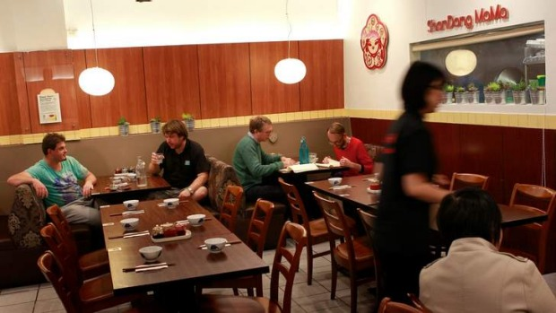 The dining room is no-frills at this arcade Chinese diner.