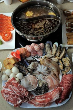 The Hot Pot Gungahlin. A seafood and meat platter with the hot pot containing two different stocks.