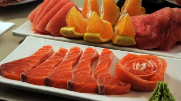 An entree of salmon sashimi and fresh fruit at Hot Pot.