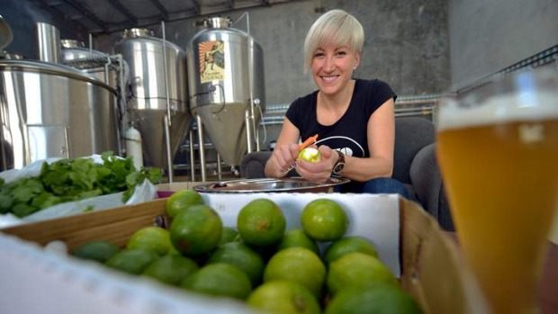 Jayne Lewis, who uses limes in her beer, hard at work. 'We've used a little bit of corn, thrown in coriander leaf and a ...